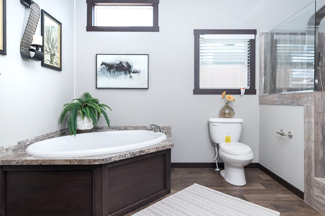 The THE SUPER FRIO 28 Master Bathroom. This Manufactured Mobile Home features 4 bedrooms and 2 baths.