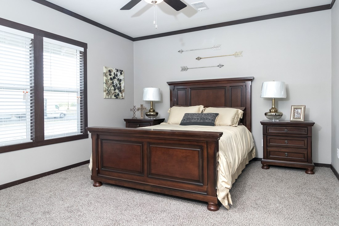 The THE SUPER FRIO 28 Master Bedroom. This Manufactured Mobile Home features 4 bedrooms and 2 baths.