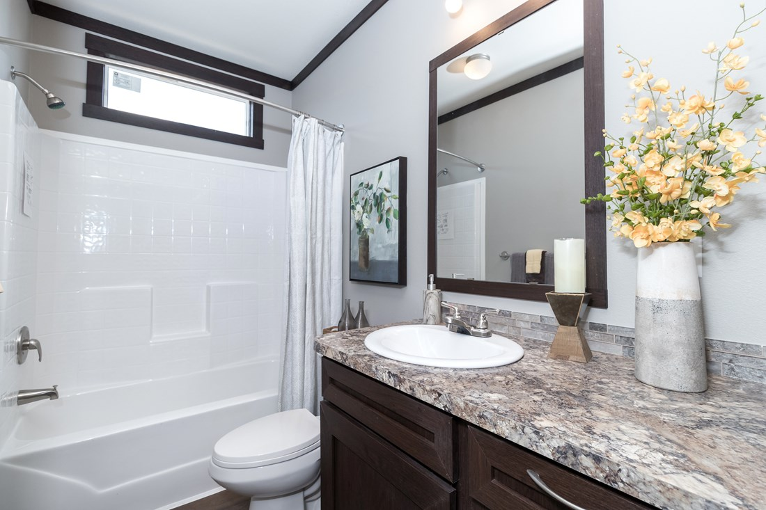 The THE SUPER FRIO 28 Guest Bathroom. This Manufactured Mobile Home features 4 bedrooms and 2 baths.
