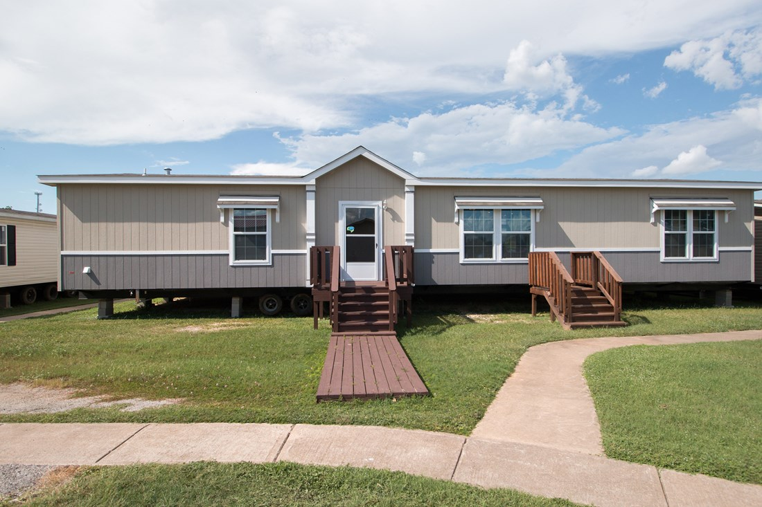 The THE SUPER HOUSTON 28 Exterior. This Manufactured Mobile Home features 4 bedrooms and 2 baths.