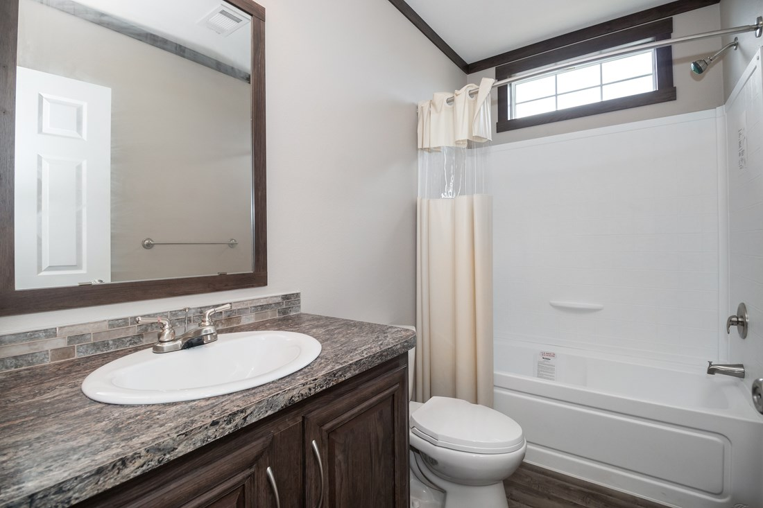 The THE SUPER HOUSTON 28 Guest Bathroom. This Manufactured Mobile Home features 4 bedrooms and 2 baths.