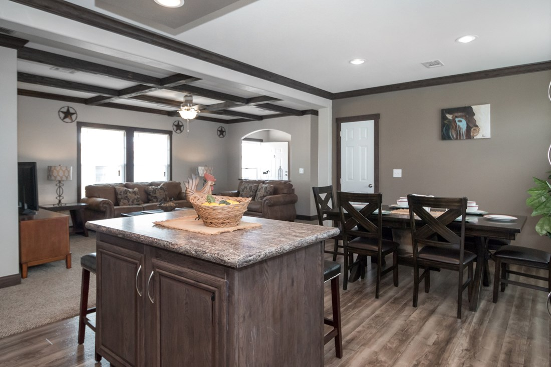 The THE SUPER HOUSTON 28 Kitchen. This Manufactured Mobile Home features 4 bedrooms and 2 baths.