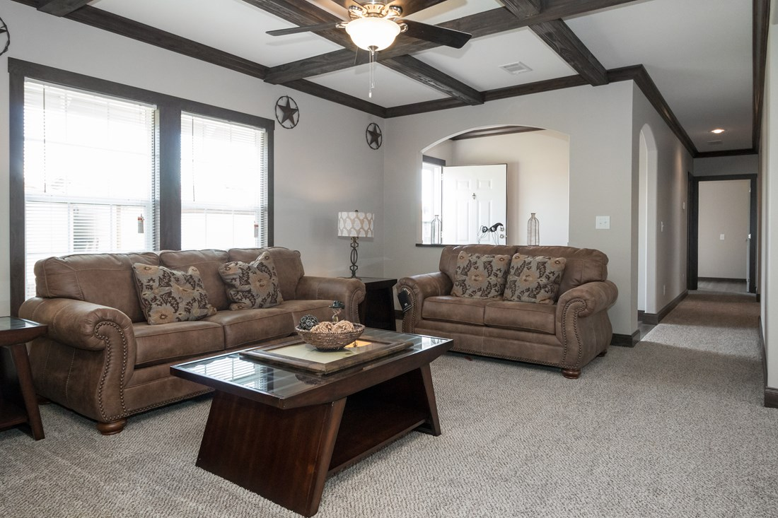 The THE SUPER HOUSTON 28 Living Room. This Manufactured Mobile Home features 4 bedrooms and 2 baths.