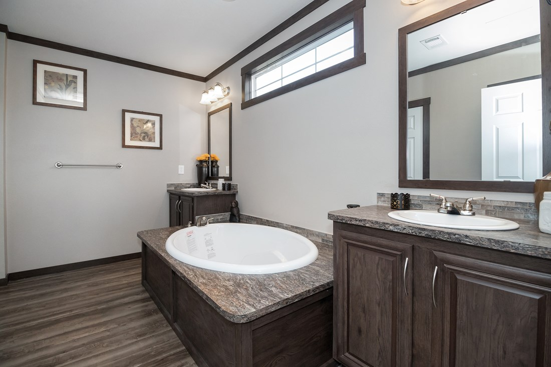 The THE SUPER HOUSTON 28 Master Bathroom. This Manufactured Mobile Home features 4 bedrooms and 2 baths.
