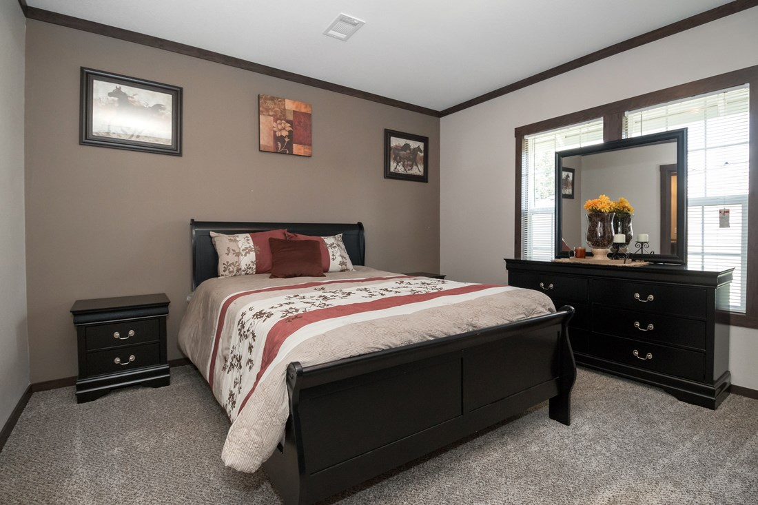 The THE SUPER HOUSTON 28 Master Bedroom. This Manufactured Mobile Home features 4 bedrooms and 2 baths.