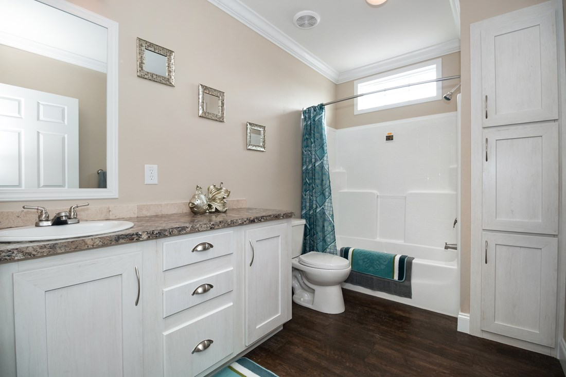 The THE PECOS 32 Guest Bathroom. This Manufactured Mobile Home features 3 bedrooms and 2 baths.