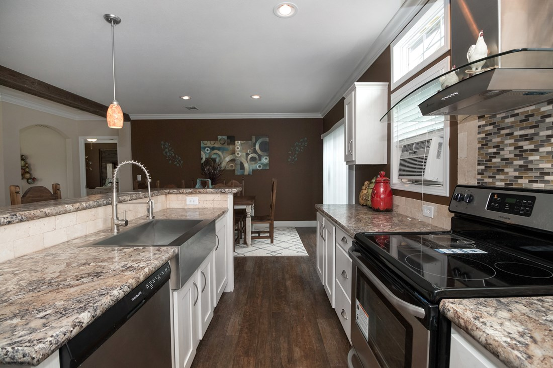 The THE PECOS 32 Kitchen. This Manufactured Mobile Home features 3 bedrooms and 2 baths.