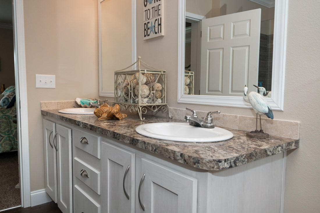 The THE PECOS 32 Master Bathroom. This Manufactured Mobile Home features 3 bedrooms and 2 baths.