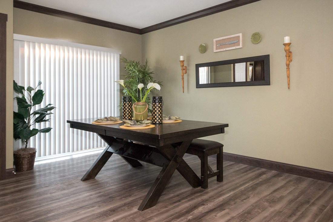 The THE SUPER FRIO 32 Dining Area. This Manufactured Mobile Home features 4 bedrooms and 2 baths.