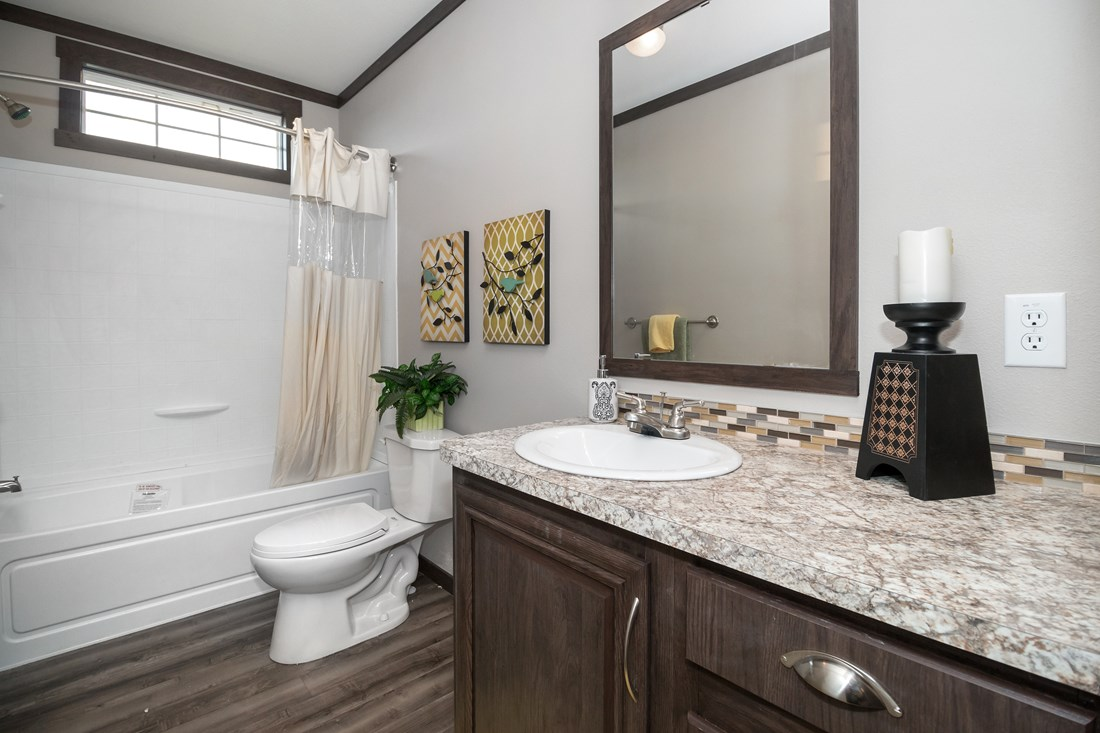 The THE SUPER FRIO 32 Guest Bathroom. This Manufactured Mobile Home features 4 bedrooms and 2 baths.