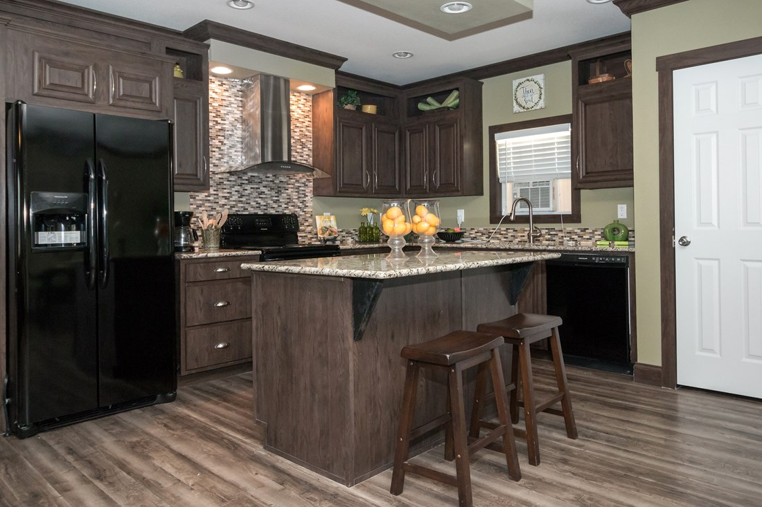 The THE SUPER FRIO 32 Kitchen. This Manufactured Mobile Home features 4 bedrooms and 2 baths.