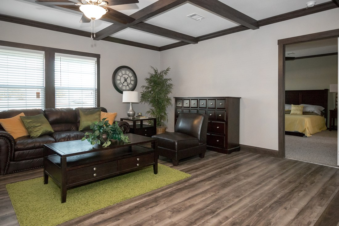 The THE SUPER FRIO 32 Living Room. This Manufactured Mobile Home features 4 bedrooms and 2 baths.