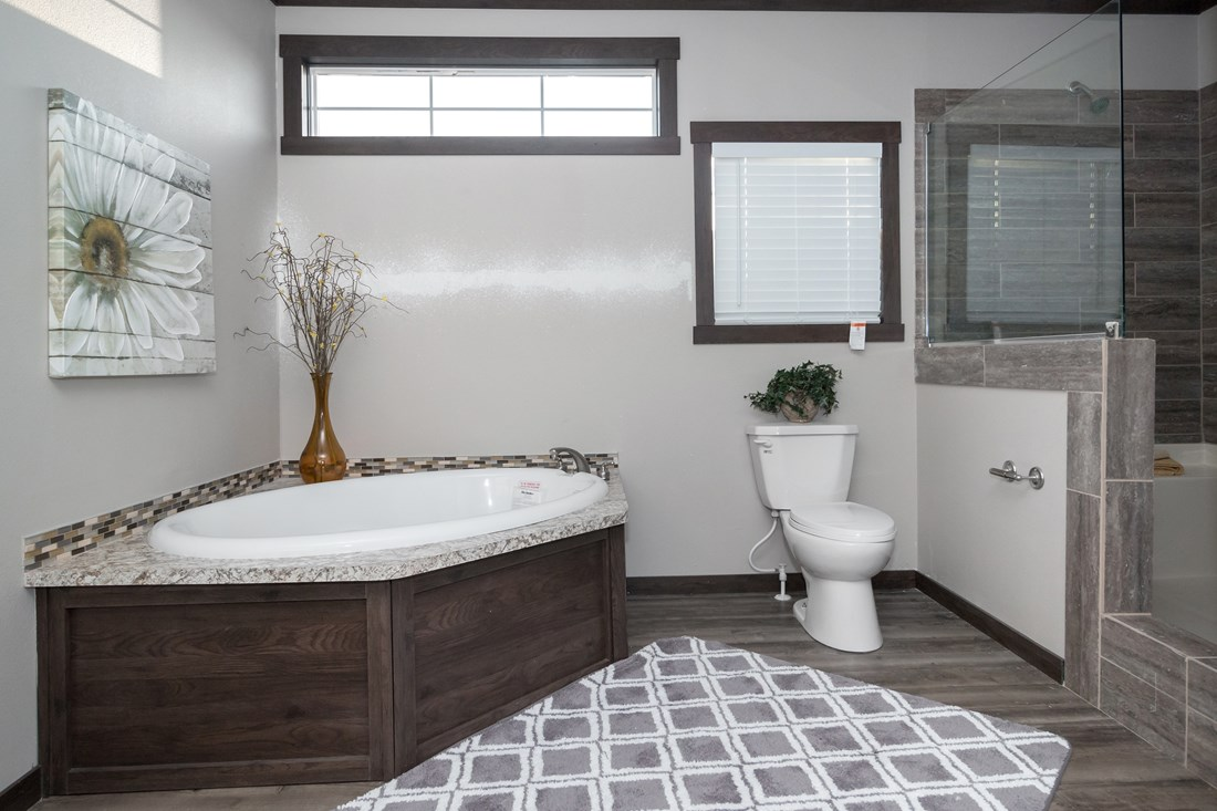 The THE SUPER FRIO 32 Master Bathroom. This Manufactured Mobile Home features 4 bedrooms and 2 baths.