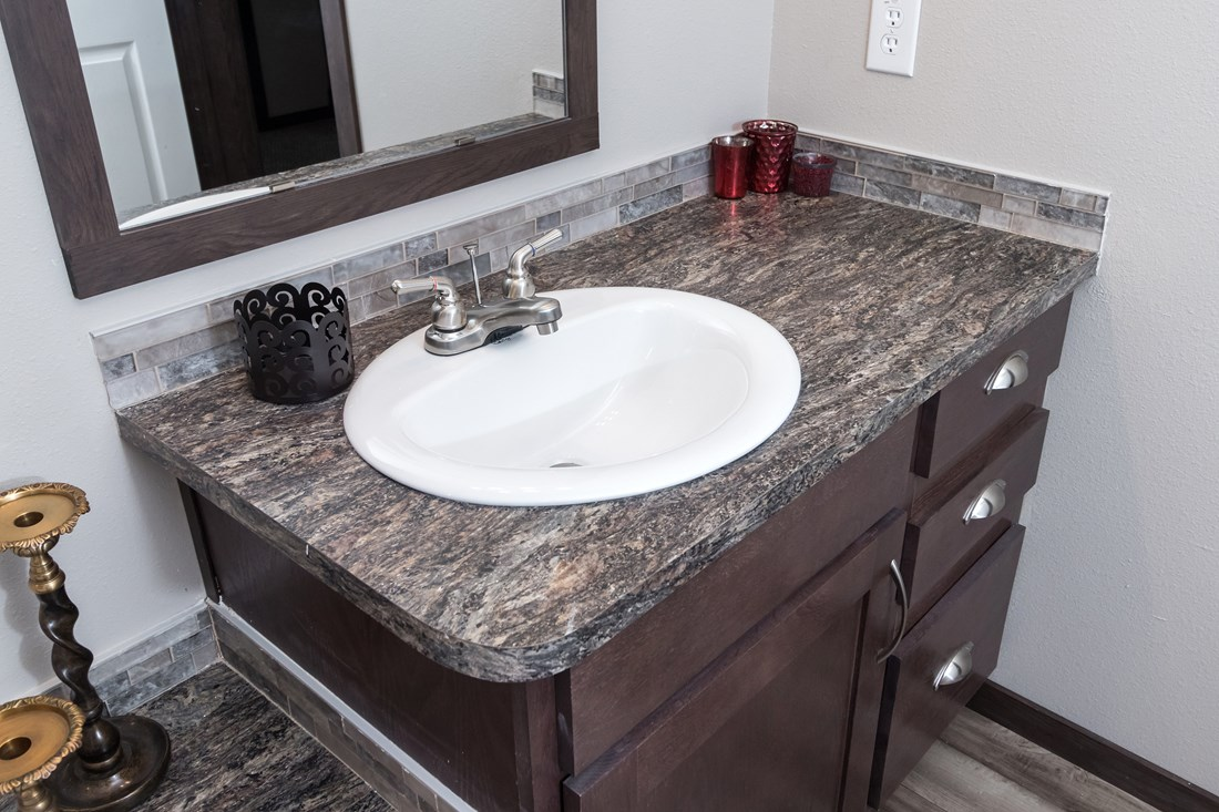 The THE SUPER HOUSTON 32 Master Bathroom. This Manufactured Mobile Home features 4 bedrooms and 2 baths.
