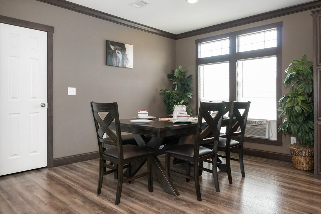 The THE SUPER HOUSTON 32 Dining Area. This Manufactured Mobile Home features 4 bedrooms and 2 baths.