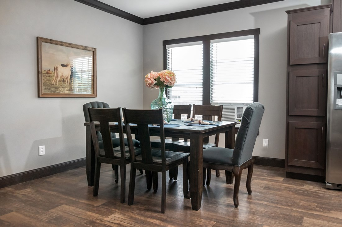 The THE NILE Dining Area. This Manufactured Mobile Home features 3 bedrooms and 2 baths.
