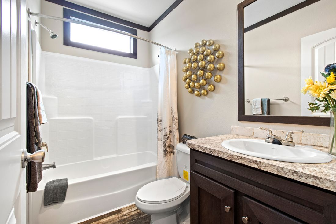 The ANNIVERSARY 3.0 Guest Bathroom. This Manufactured Mobile Home features 3 bedrooms and 2 baths.