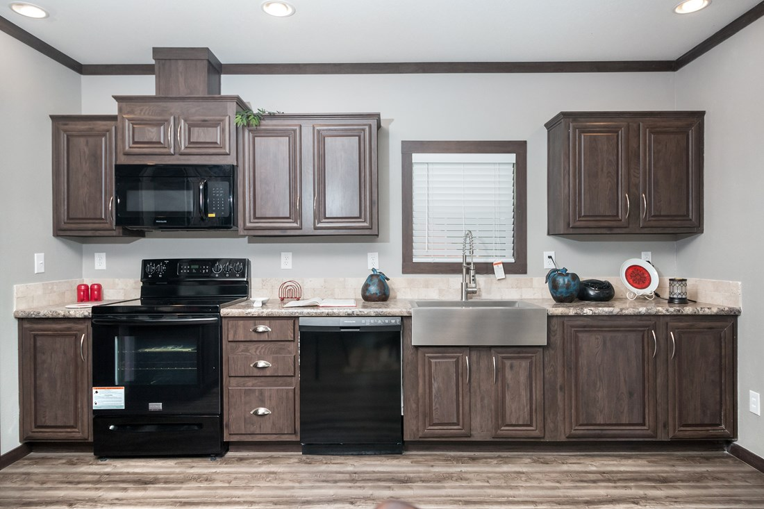 The THE HOGAN 32 Kitchen. This Manufactured Mobile Home features 3 bedrooms and 2 baths.