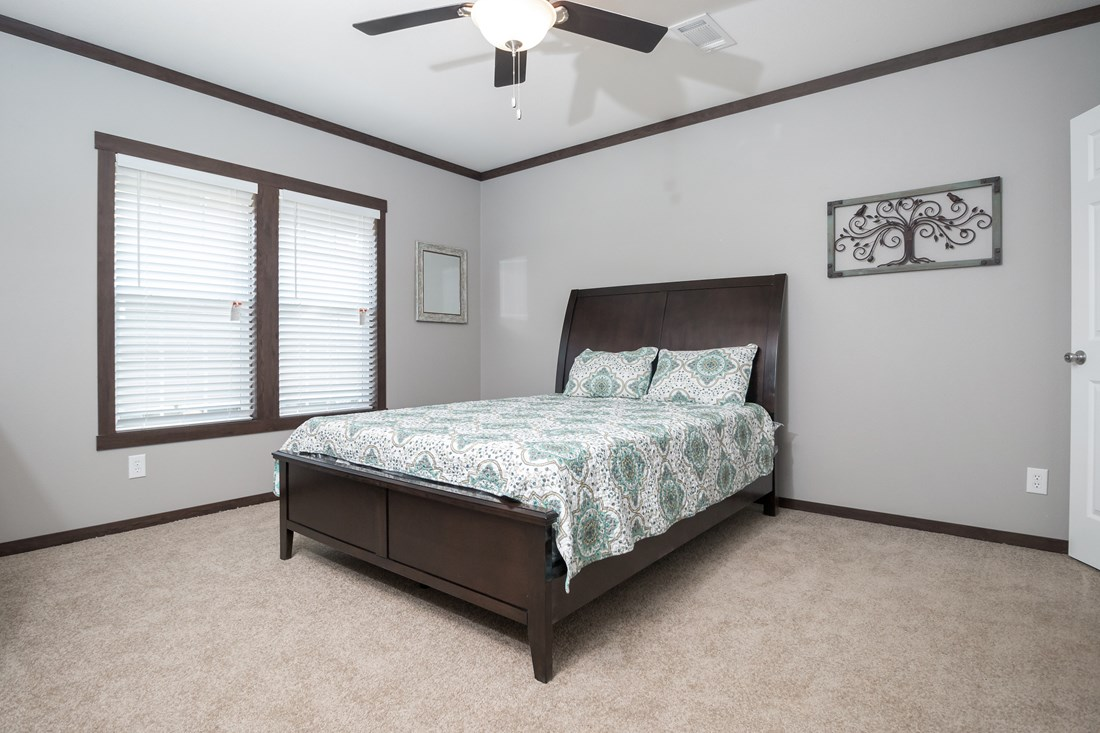 The THE HOGAN 32 Master Bedroom. This Manufactured Mobile Home features 3 bedrooms and 2 baths.