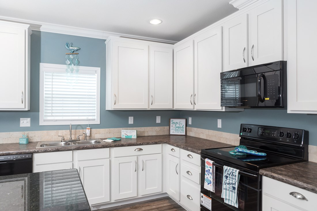 The THE JEFFERSON 28 Kitchen. This Manufactured Mobile Home features 4 bedrooms and 2 baths.