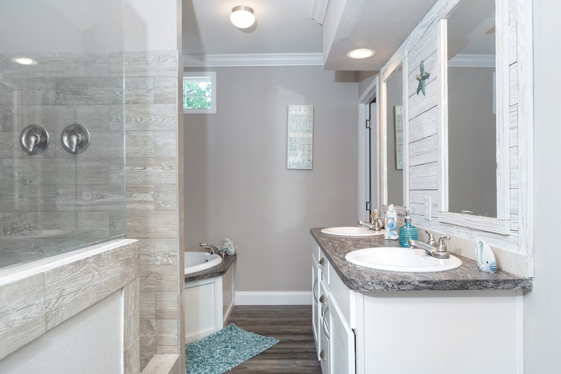 The THE JEFFERSON 28 Master Bathroom. This Manufactured Mobile Home features 4 bedrooms and 2 baths.