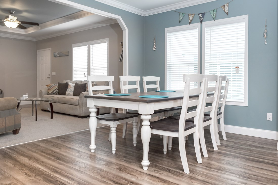 The THE JEFFERSON 28 Dining Area. This Manufactured Mobile Home features 4 bedrooms and 2 baths.