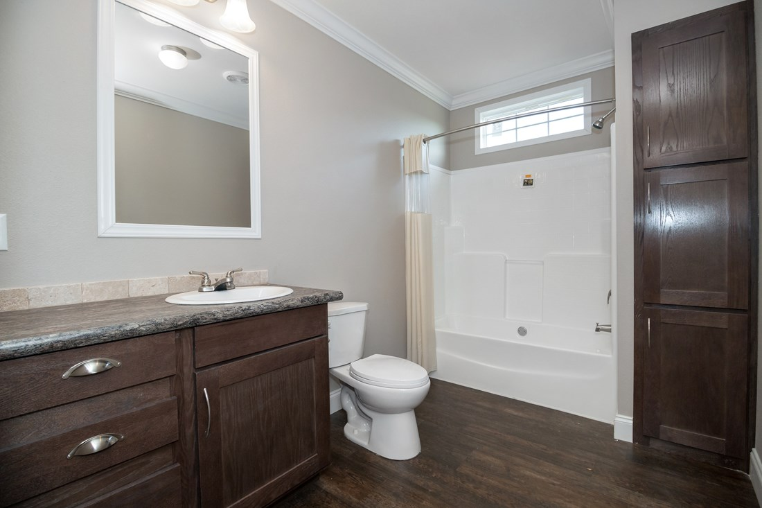 The THE FRANKLIN 32 Guest Bathroom. This Manufactured Mobile Home features 4 bedrooms and 2 baths.