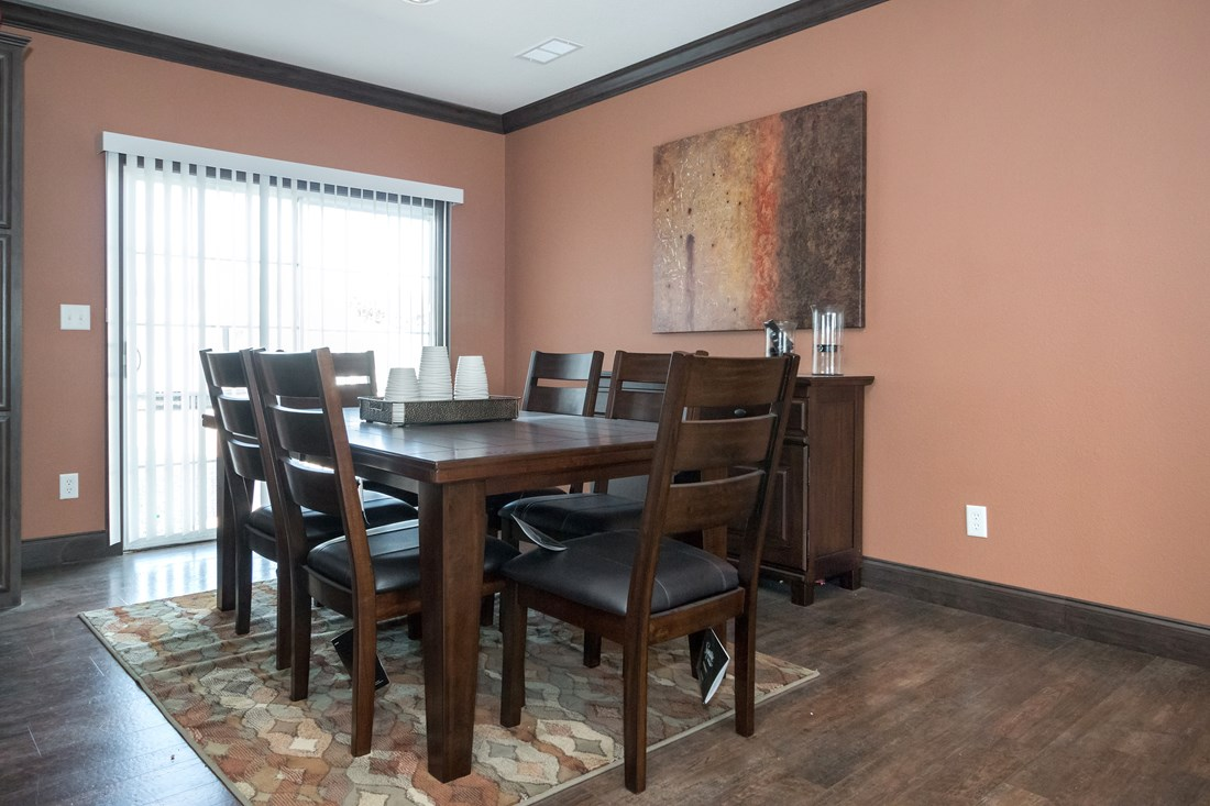 The THE STRETCH FRIO 32 Dining Area. This Manufactured Mobile Home features 3 bedrooms and 2 baths.