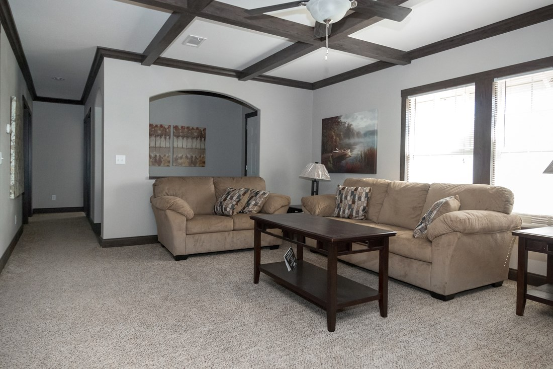 The THE STRETCH FRIO 32 Living Room. This Manufactured Mobile Home features 3 bedrooms and 2 baths.