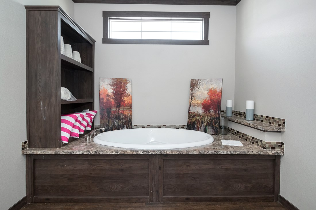 The THE STRETCH FRIO 32 Master Bathroom. This Manufactured Mobile Home features 3 bedrooms and 2 baths.