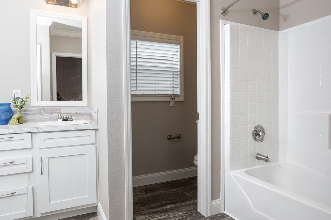 The THE BIG CLASSIC Guest Bathroom. This Manufactured Mobile Home features 4 bedrooms and 2 baths.