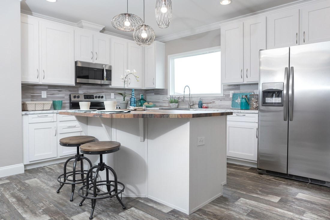 The THE BIG CLASSIC Kitchen. This Manufactured Mobile Home features 4 bedrooms and 2 baths.