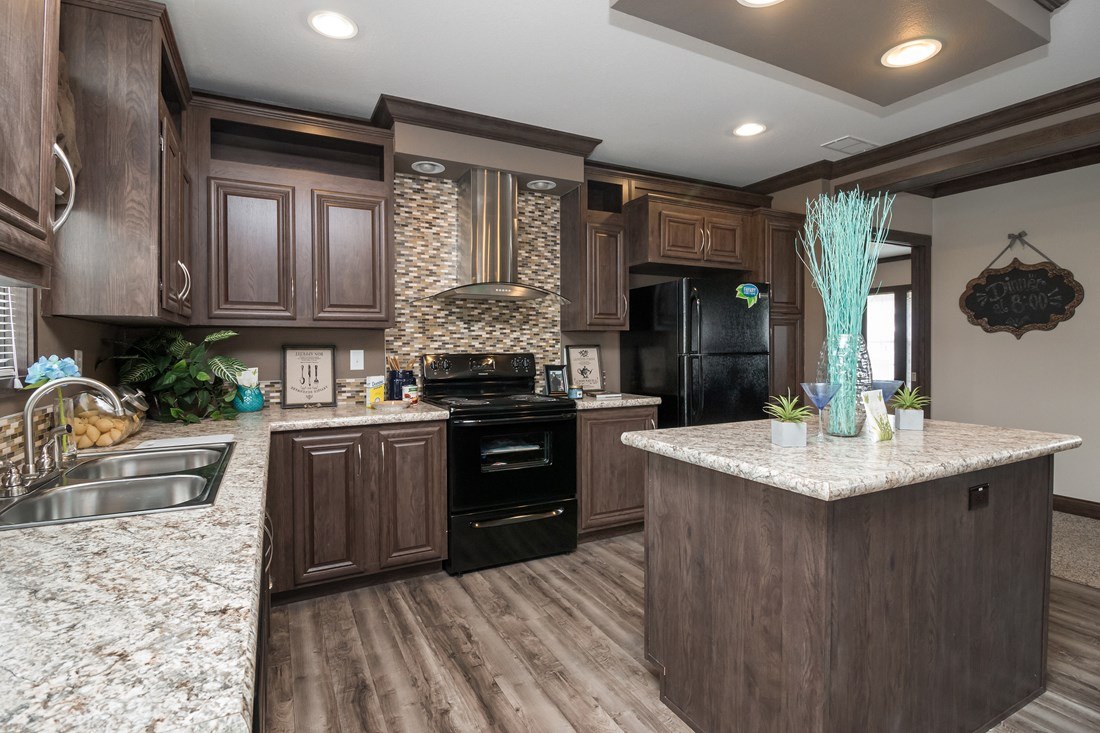 The THE STRETCH HOUSTON 32 Kitchen. This Manufactured Mobile Home features 3 bedrooms and 2 baths.
