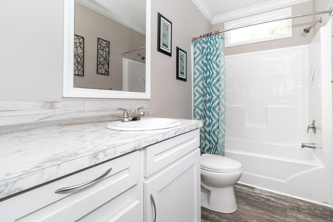 The THE TALLAHASSEE Guest Bathroom. This Manufactured Mobile Home features 3 bedrooms and 2 baths.