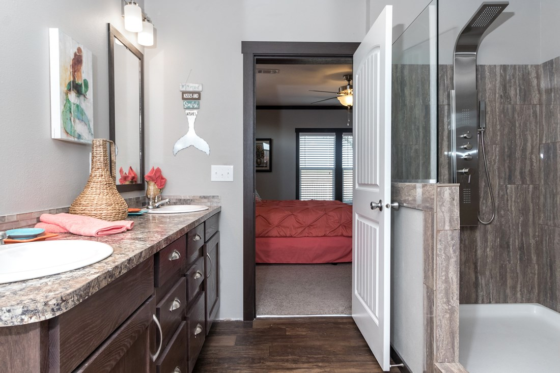 The THE PHOENIX Guest Bathroom. This Manufactured Mobile Home features 4 bedrooms and 2 baths.